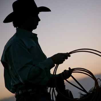 A cowboy holding a rope
